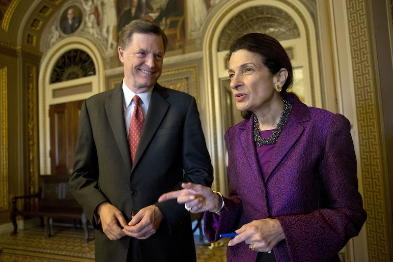 "Retiring Sen. Olympia Snowe, R-Maine, accompanied by her husband, former Maine Gov. John ""Jock"" McKernan Jr., talks on Capitol Hill in Washington on Thursday after giving her farewell speech in the Senate chamber. Snowe said she remains hopeful that the Senate can overcome ""excessive political polarization"" to work together to reach consensus on important issues facing the nation."