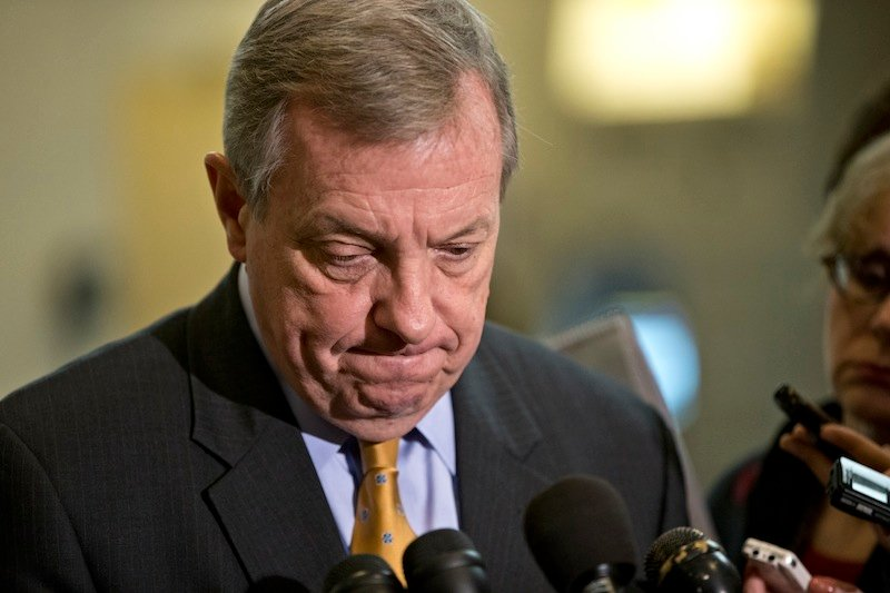 Sen. Dick Durbin, D-Ill., a member of the Senate Foreign Relations Committee, pauses as he speaks to reporters following a closed-door briefing on the investigation of the deadly Sept. 11 attack on the U.S. consulate in Benghazi, Libya, at the Capitol in Washington, Wednesday, Dec. 19, 2012. An Accountability Review Board's report indicates serious bureaucratic mismanagement was responsible for the inadequate security at the mission in Benghazi where the U.S. ambassador and three other Americans were killed. (AP Photo/J. Scott Applewhite)