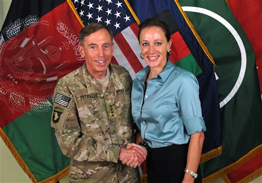 """This July 13, 2011, photo, shows former Gen. David Petraeus shaking hands with Paula Broadwell, co-author of """"All In: The Education of General David Petraeus."""""""