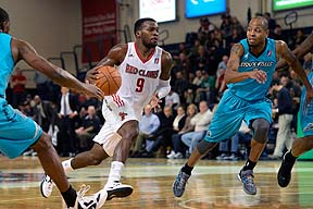 Shelvin Mack of the Maine Red Claws drives toward the basket as Troy Hudson of Sioux Falls moves in on defense Sunday at the Portland Expo. The Claws lost, 98-87.