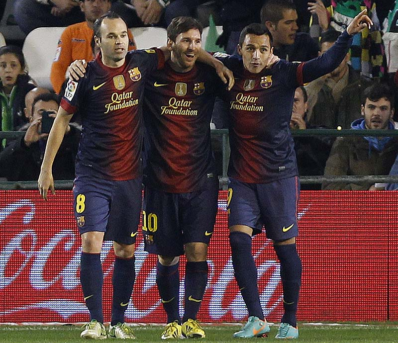 Barcelona's Messi, middle, celebrates with teammates Andres Iniesta, left, and Alexis Sanchez after scoring against Betis during their La Liga soccer match at the Benito Villamarin stadium, in Seville, Spain. XLALIGAX