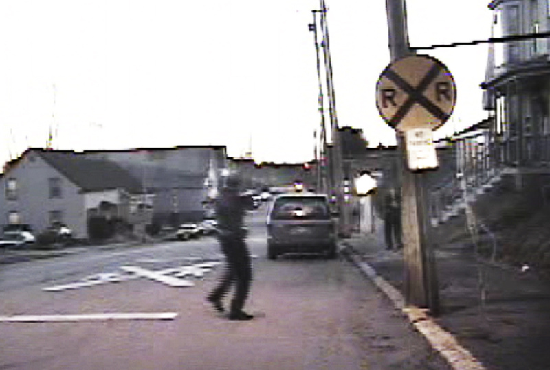 Biddeford Police Sgt. Jeffrey Greene orders Barbara Stewart to drop her weapon moments before he fatally shot her in this March 24, 2009, image taken from a cruiser video. Stewart advanced on Greene, pointing what appeared to be a semi-automatic handgun at him. According to the Office of the Attorney General's investigative file, police later learned it was a pellet gun and that Stewart was intent on suicide.