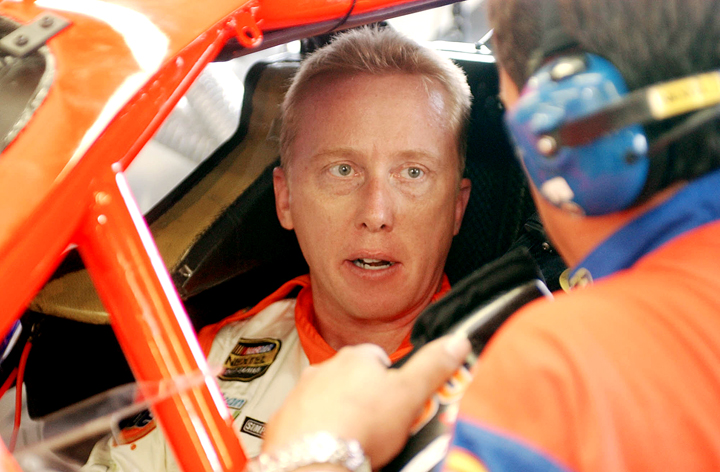 In this July 2004 photo, NASCAR driver Ricky Craven of Newburgh, Maine, talks with Doug Holbrook before practice for the Nextel Cup Siemens 300 at New Hampshire International Speedway in Loudon, N.H.