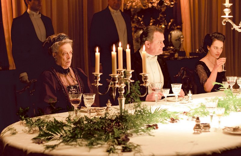 "Maggie Smith and Hugh Bonneville, the Dowager Countess and Earl of Grantham respectively, ""at table"" in another scene from the show. American fans of the PBS series will be able to imitate this marvelously styled fantasy of British life when a company called Knockout Licensing launches multiple brands that seek to replicate the look of ""Downton"" in North American homes."