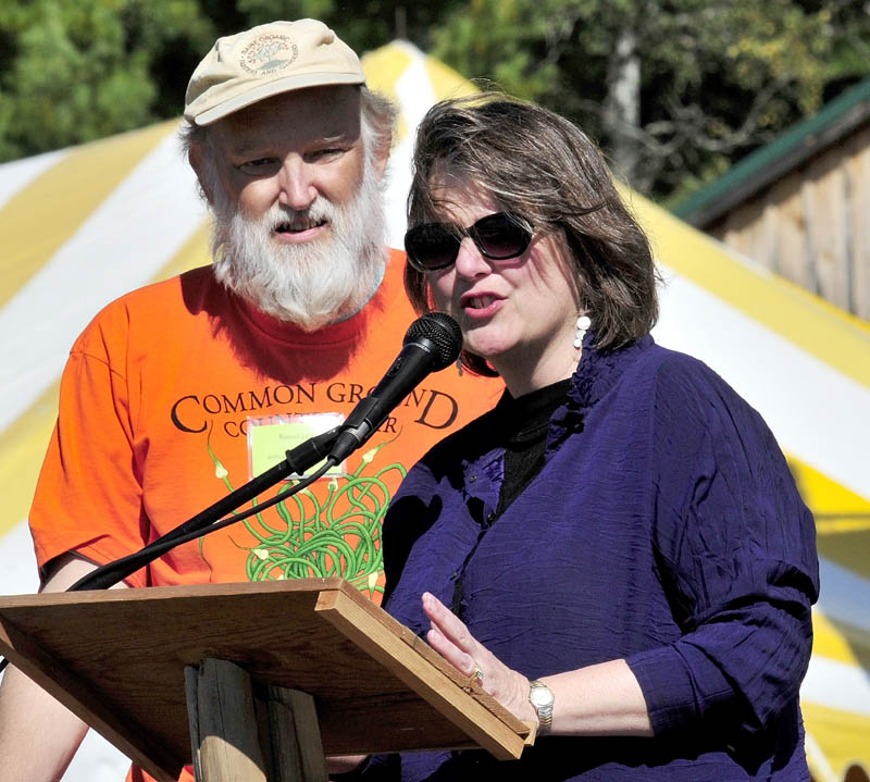 Maine Organic Farmers and Gardeners Association Executive Director Russell Libby introduces Kathleen Merrigan at the Common Ground Country Fair on Sept. 23. Libby, executive director of the organization for 17 years, died on Sunday.