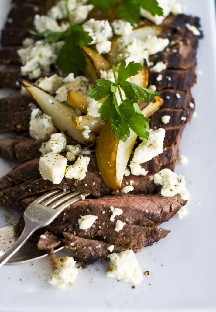 Balsamic-pepper flank steak with grilled pear and blue cheese is shown. The cut is meant to be lightly grilled or broiled. It also loves to be marinated.