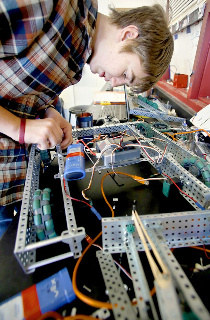 Walker Grimes, 15, a sophomore, works on his robot as he along with other members of the Cape Robotics Club prepare for the third annual Southern Maine VEX Robotics Tournament at Cape Elizabeth High School on Friday.