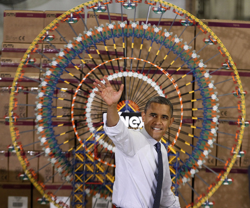 "President Obama waves as he leaves after speaking at the K'Nex factory in Hatfield, Pa., on Friday. ""In Washington, nothing's easy, so there's going to be some prolonged negotiations,"" Obama said."