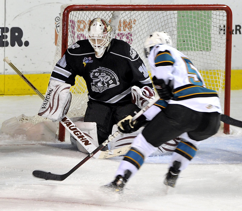 Pirates goalie Chad Johnson braces for a shot from Worcester's Matt Tennyson during Friday's game at the Cumberland County Civic Center. Portland won, 4-3.