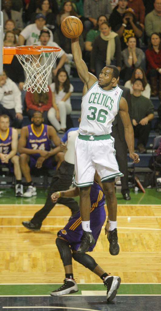 Chris Wright of the Red Claws dunks on a breakaway in the fourth quarter. He finished with 19 points in the game.