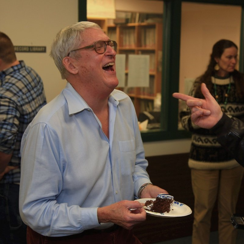 Toby Leboutillier celebrates with cake after learning the show will go on.