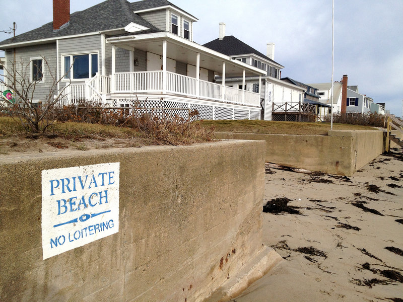 "A sign posted on a seawall at Moody Beach proclaims, ""Private Beach. No Loitering."" Property owners there won a landmark 1989 case affirming private ownership of the shore straight to the low-water mark. Unlike most other states, Maine's beaches and other intertidal property are not owned by the state, though recent court cases have increased public access rights."