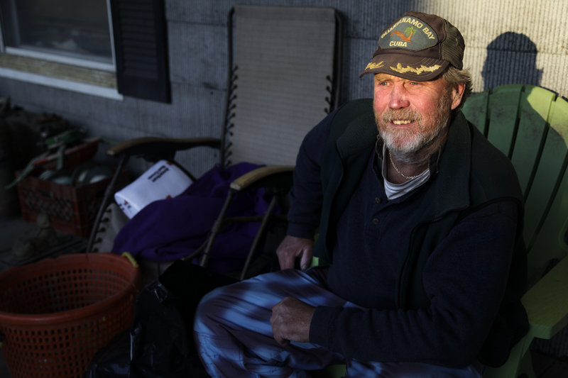 John Frawley sits on the porch of his house, which was damaged during Superstorm Sandy, on the Rockaway Peninsula in New York on Thursday.