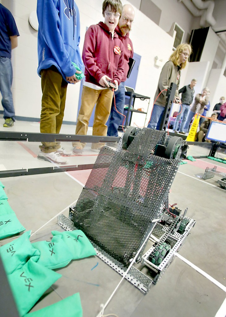 Mac Brucker, 13, a member of the Cape Robotics Club, picks up sacks with his team's robot Saturday in the Vex Sack Attack competition. Twenty-seven teams competed in Saturday's tournament.