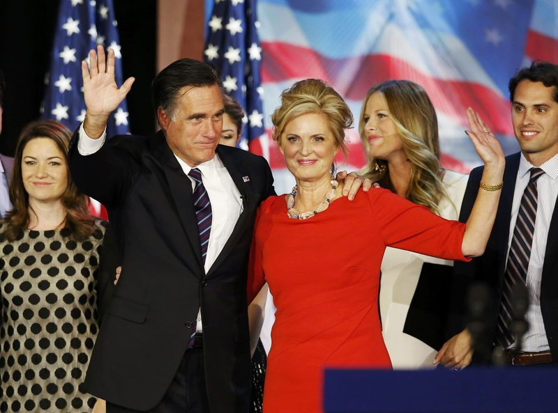"Republican presidential nominee Mitt Romney stands on stage with his wife, Ann, after he delivered his concession speech in Boston. Friends say the also-ran isn't bitter about his loss. Bitterness ""is not in the family genetic code,"" said one. Friends say the loss has been harder on Ann, who they report has been crying in private."
