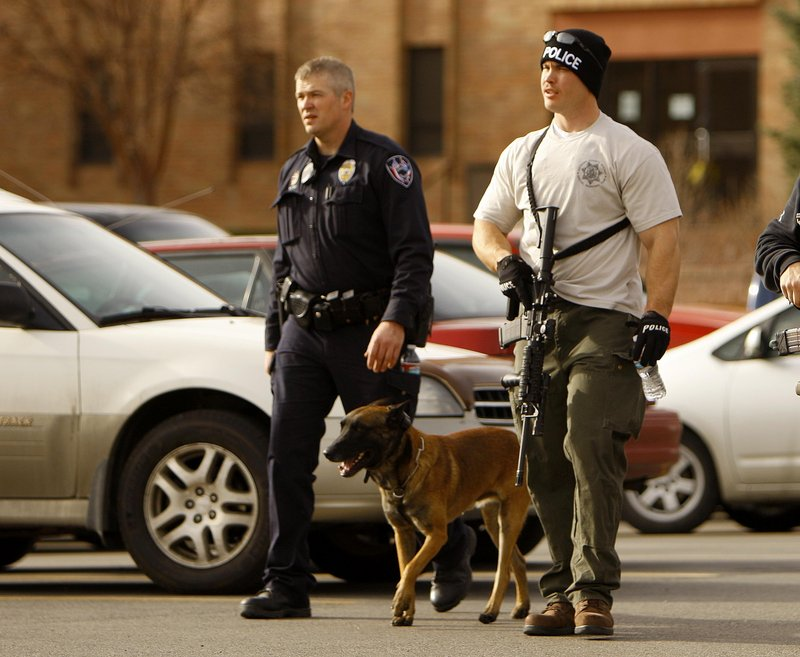 Casper police leave the Wold Physical Science Building at Casper College on Friday in Casper, Wyo., where a man killed a teacher and himself in front of college students.