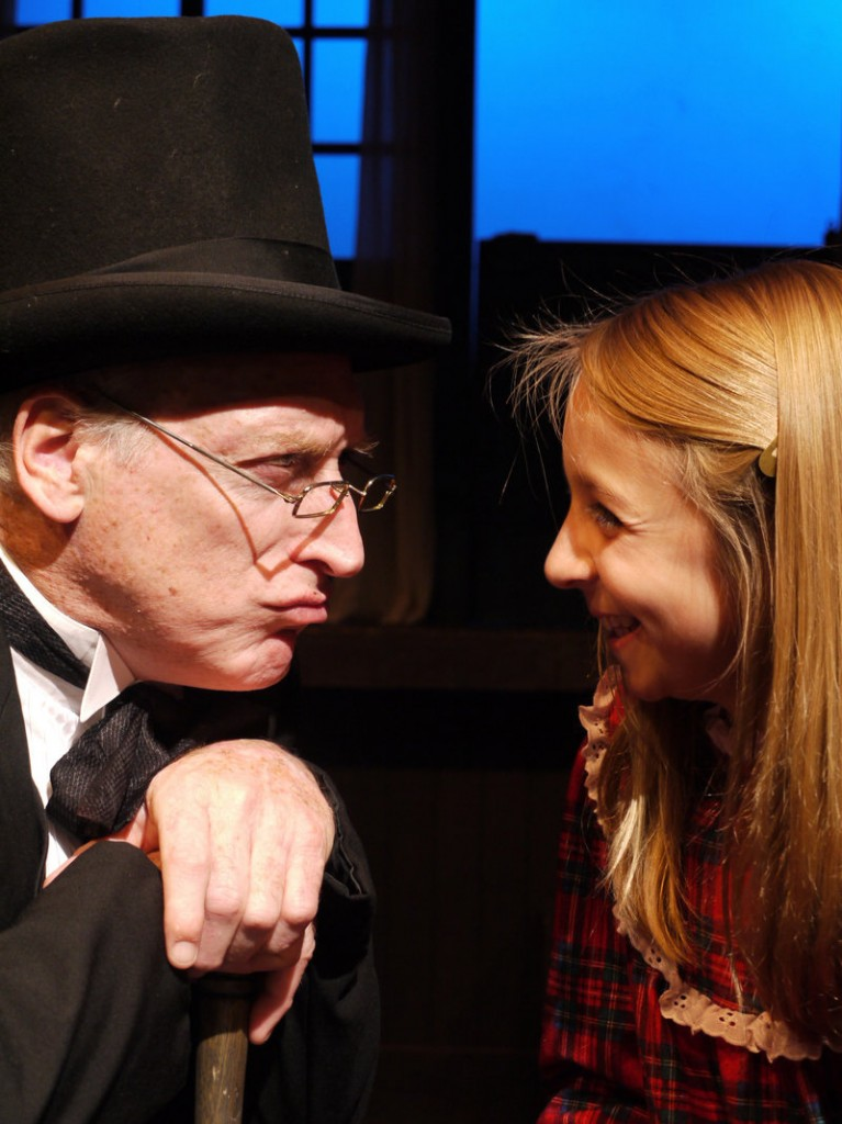 "Joel Leffert as Scrooge and Maddy Leslie as Tiny Tim in The Public Theatre production of ""A Christmas Carol."""