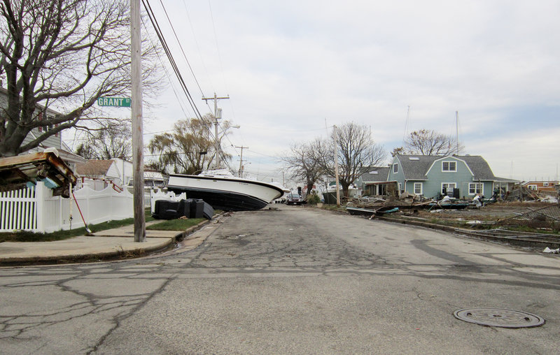 A boat rests on property several blocks inland in a seaside neighborhoods of Freeport, N.Y., in the wake of Superstorm Sandy, which hit the Northeast on Oct. 29.