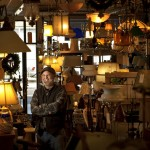 Brian Allen, owner of The Lamp Repair Shop in South Portland, is surrounded by lamps – some are repair jobs, some are his okwn creations. Allen started the business in 1986, and moved it to Knightville in 2002.