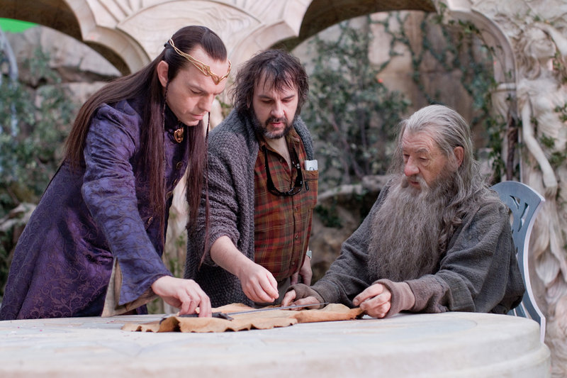 "Hugo Weaving as the elven leader Elrond, left, director Peter Jackson and Ian McKellen as Gandalf the Grey on the set of the fantasy adventure, ""The Hobbit: An Unexpected Journey."""