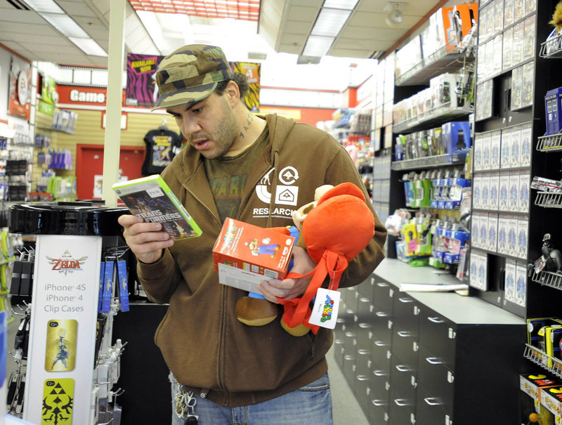 """Brian Hunt of Middle River, Md., shops at GameStop Kids in White Marsh Mall in Nottingham, Md. """"It's hard to find Mario stuff,"""" he said. """"Most of the game shopping we do is for the kids, and this is kid-friendly."""""""