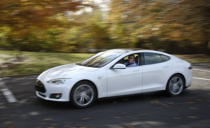 Peter Spirgel, an attorney, drives his new electric car, a Tesla Model S Performance, last month in Cherry Hill, N.J.
