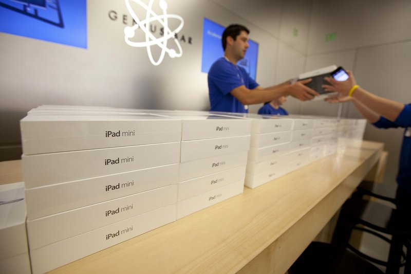 An Apple specialist hands over the new Apple iPad mini to a customer at an Apple store in San Francisco. The iPad Mini sells for $329, which helps Apple protect its profit margins and preserve its reputation for selling top-of-the-line products that merit prices a notch above the competition. Nevertheless, the iPad mini is undoubtedly diverting some sales from full-sized iPads, which sell at prices ranging from $399 to $829. That is one of the reasons BGC Financial analyst Colin Gillis expects the iPad's average selling price to fall by about $50 in the current quarter.