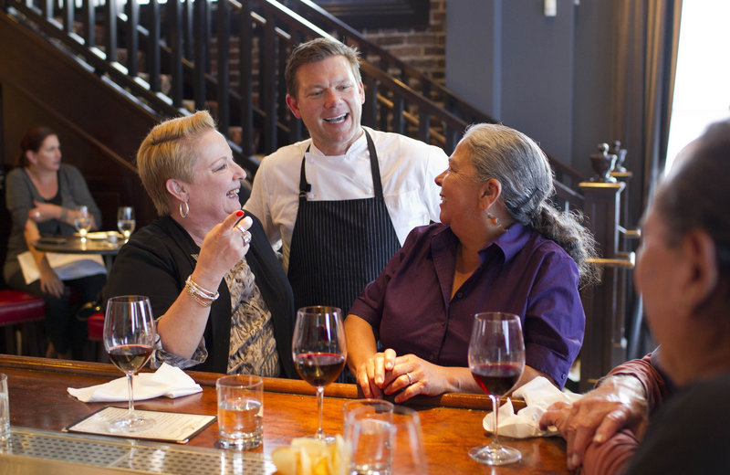 Tyler Florence visits with customers at his Wayfare Tavern in San Francisco.