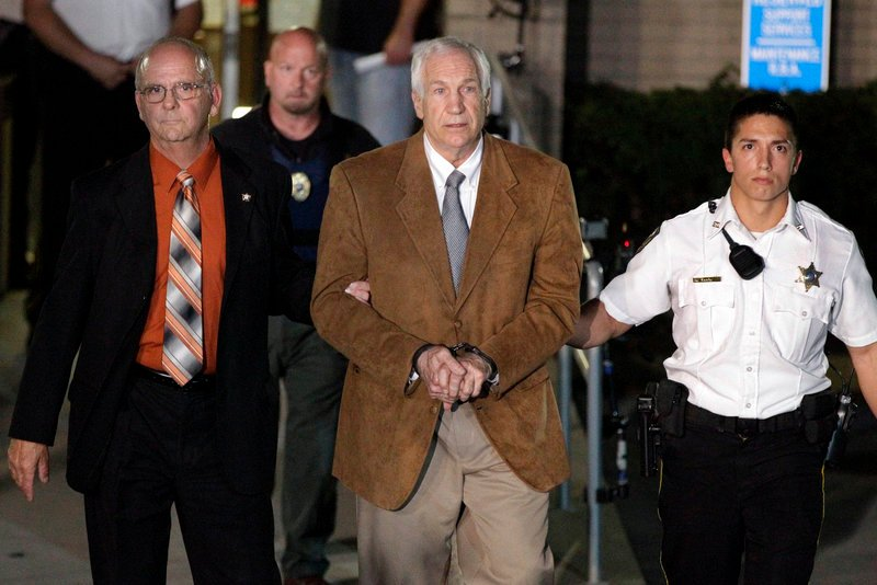 Ex-Penn State assistant football coach Jerry Sandusky leaves court after being found guilty of multiple charges of child sexual abuse.