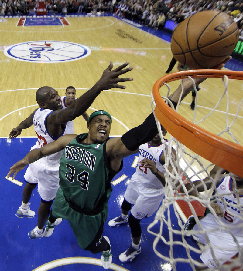 Paul Pierce of the Boston Celtics drives past Jason Richardson of the Philadelphia 76ers for a basket Friday night in the first half of the Sixers' 95-94 overtime victory.