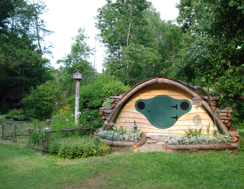 "A Hobbit Hole playhouse with natural landscaping pays homage to the homes in the Shire, from J.R.R. Tolkien's 1937 fantasy novel ""The Hobbit."""