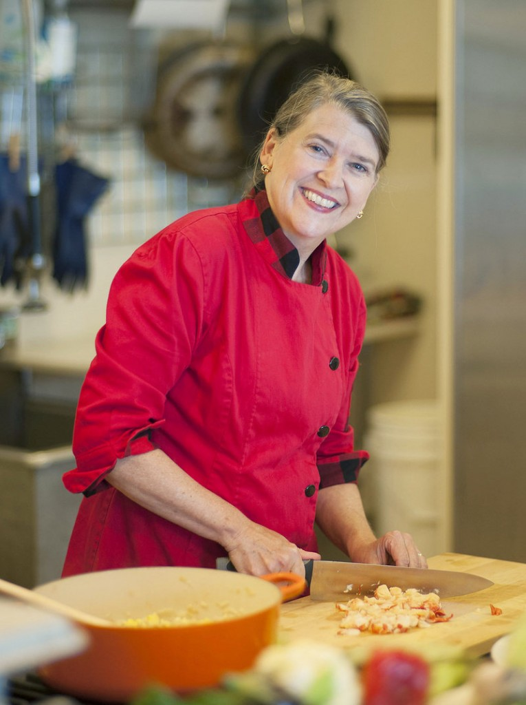 Cheryl Wixson in the kitchen of her Bangor home, which has been transformed into the headquarters of her company that produces hand-crafted prepared foods such as pasta sauce, applesauce, ketchup, relish and jams in small batches using all Maine ingredients.