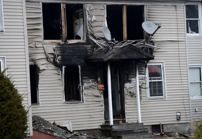 In this Monday, Dec. 10 photo, a three-unit Windham apartment building on Gray Road that was damaged by fire on Friday.