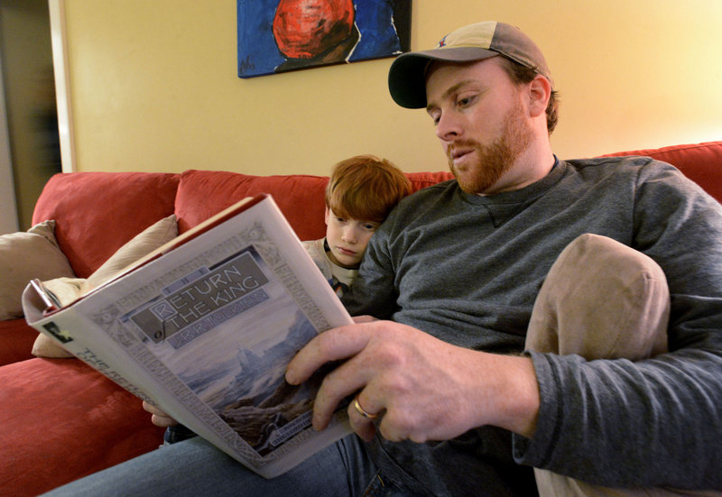 "Jeff Shaw reads to his son Brayden, 7, from ""The Return of the King"" by J.R.R. Tolkien. They plan to see ""The Hobbit: An Unexpected Journey."""