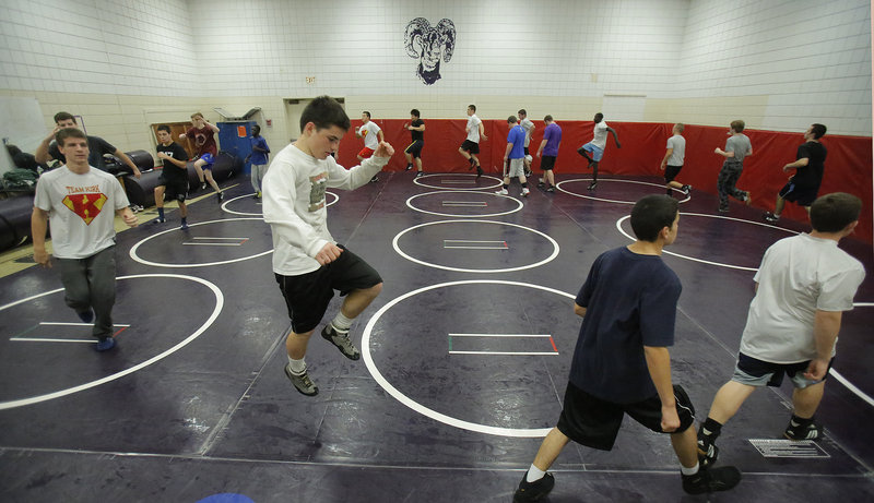 Iain Whitis of Cheverus warms up before practice Monday at Deering High. Whitis and several other independent wrestlers have found wrestling homes at other schools but can't compete for those schools during dual meets and tournaments.