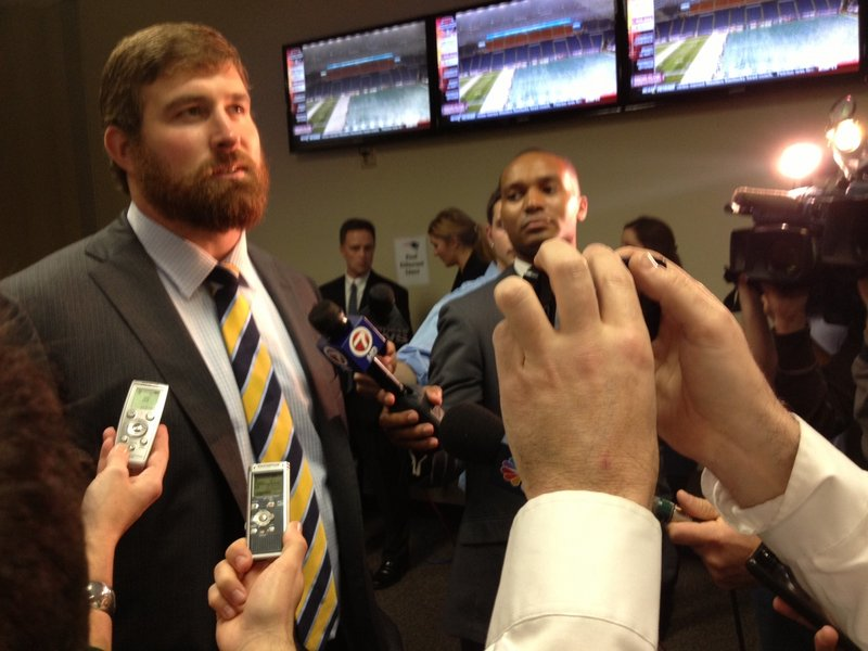 Matt Light, a former lineman for the Patriots, speaks to reporters before the game Monday. Light was honored at halftime for his contributions to a team that dominated the AFC East during his 11-year career.