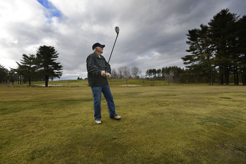 Norm McDonald of Gorham watches his approach shot on the 10th hole at Riverside Golf Course in Portland on Tuesday, Dec. 11, 2012.
