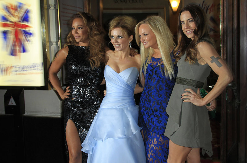 "At the theater in London Tuesday, Spice Girls, from left, Mel B, Geri Halliwell, Emma Bunton and Mel C arrive for the press showing of ""Viva Forever!"""