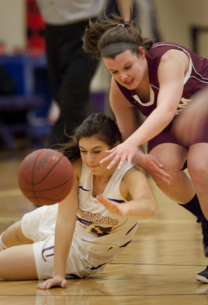 Victoria Nappi of Cheverus, left, and Abby Hamilton of Gorham have their eyes set on a loose ball. Cheverus improved to 2-0; Gorham fell to 0-2.