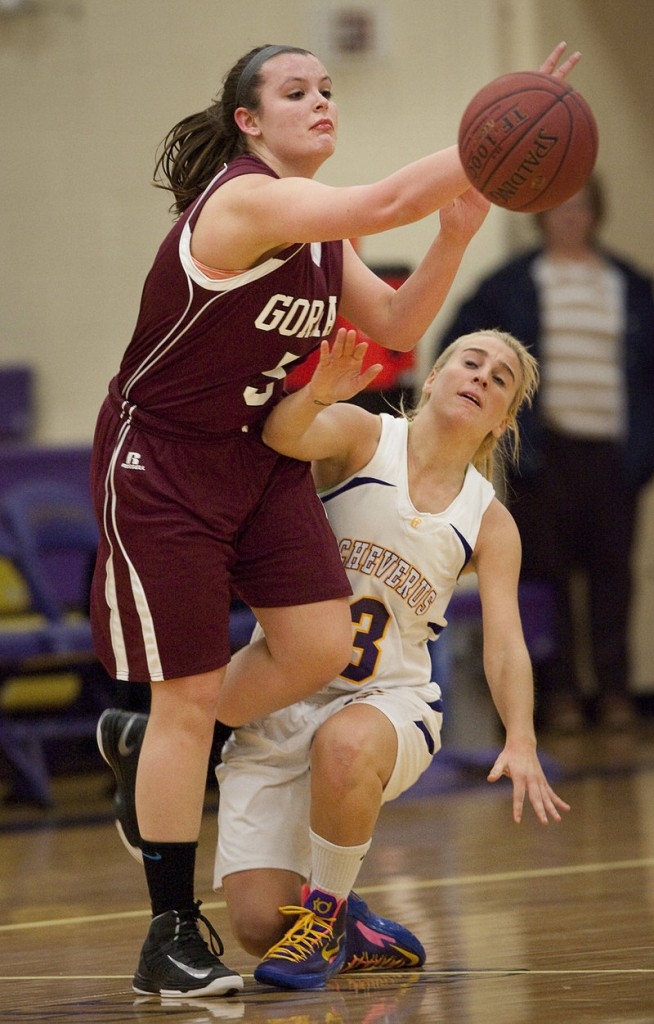 Abby Hamilton of Gorham attempts to pass Tuesday night as Danielle Kane moves in for Cheverus during Cheverus' 57-32 victory at home.