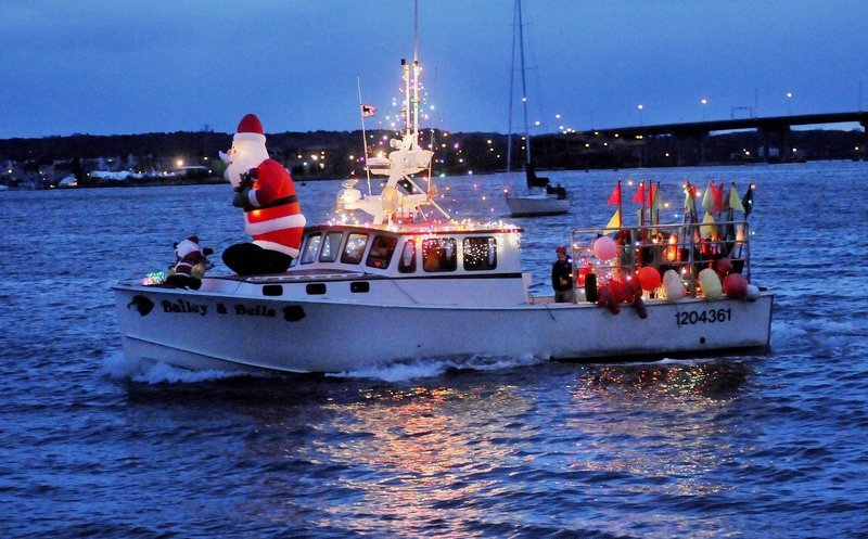 The annual Parade of Lights, photographed here in 2014, is scheduled to start at 8 p.m. this Saturday in Portland Harbor.
