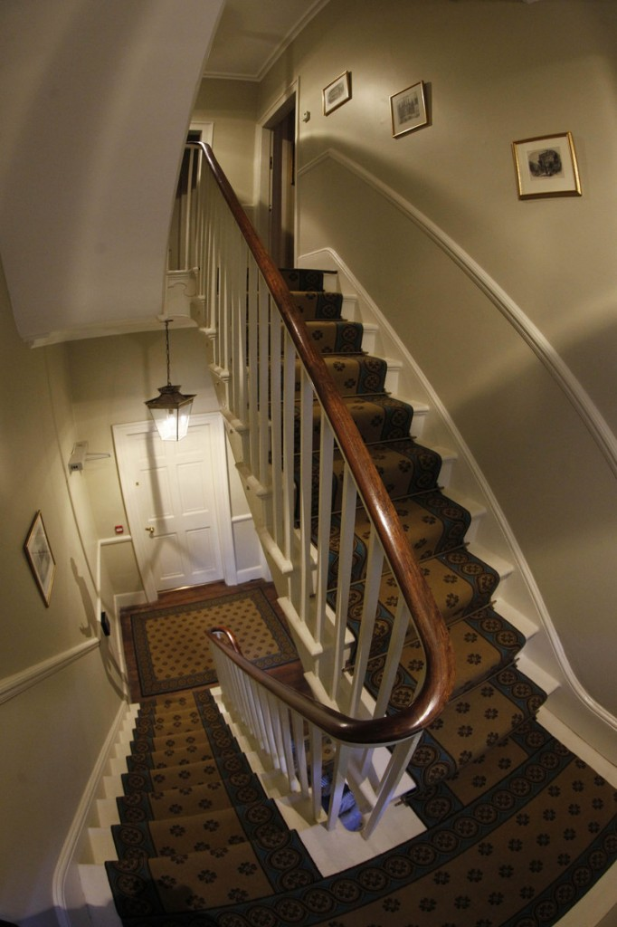 The staircase leads to the drawing room and bedrooms with other Dickens furnishings.
