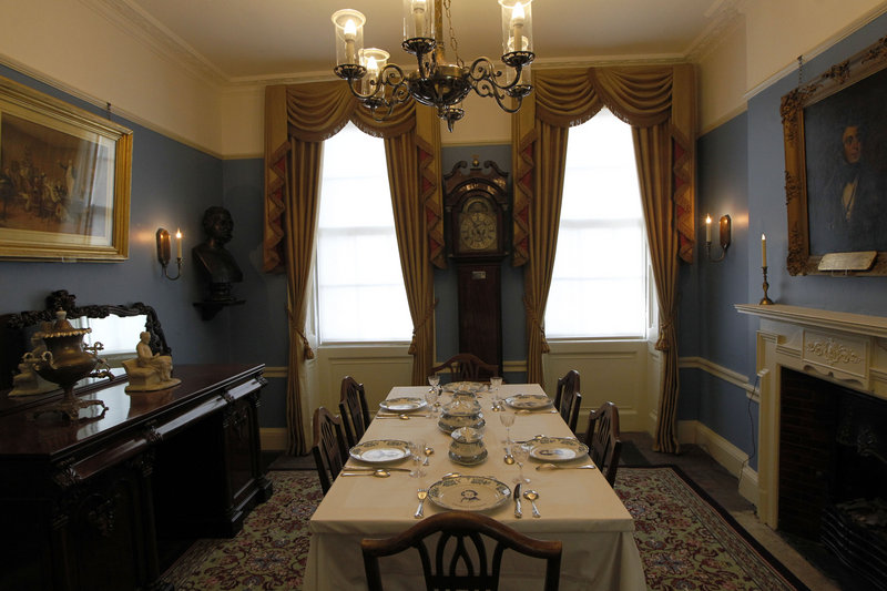 The orginal sideboard and a portrait of Dickens grace the dining room.