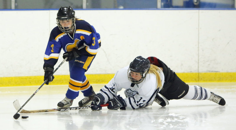 Katie Rutherford of Portland/Deering stretches Wednesday in an attempt to knock the puck from Abby Payson of Falmouth during their schoolgirl hockey game at the Portland Ice Arena. Falmouth improved to 3-3 with a 4-1 victory. The Bulldogs fell to 1-4-1.