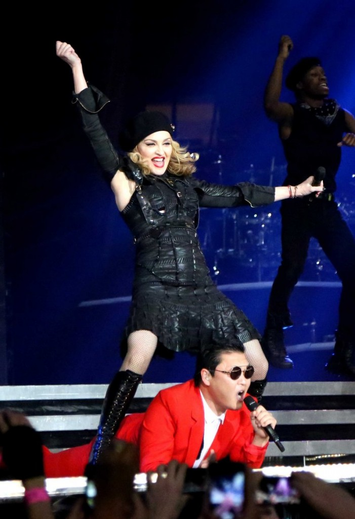"South Korean rapper PSY, performs with Madonna. PSY's ""Gangnam Style"" music video was second only to Whitney Houston in 2012 searches."