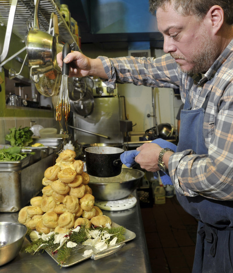 "Gerow drizzles the ""cage"" of spun sugar over his clementine-cream-stuffed profiteroles."
