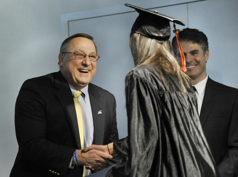 Governor Paul LePage congratulates graduate Heather Taylor a the Youth Building Alternatives Graduation ceremony at the Portland Public Library on Friday.
