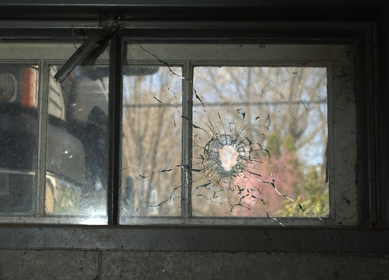 In this photo released by the New Hampshire Attorney General's Office shows a bullet hole from a basement window at a home in Greenland, N.H. Attorney General Michael Delaney said Friday Dec. 14, 2012 the hole came from a shot fired by Cullen Mutrie Aug. 12, 2012 that killed Greenland Police Chief Michael Maloney during a drug raid. (AP Photo/HO/NHAttorney General's Office)