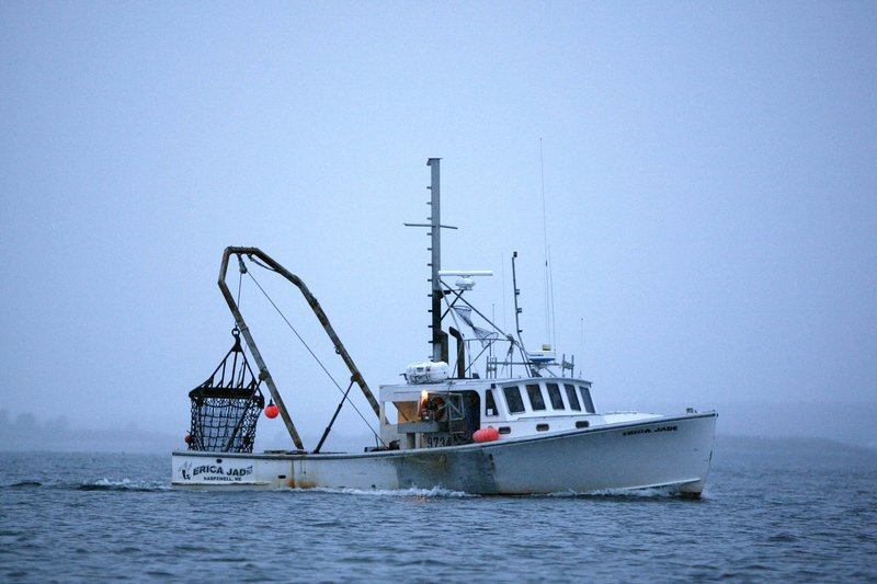 A scallop fishing boat heads out at dawn off Harpswell last year. Bottom-dragging scallopers are among the fishermen allowed in at various times to zones that exclude groundfishermen.