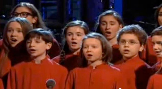 Members of the New York City Children's Chorus sing at the beginning of